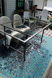 Broken glass top patio table redone with wood