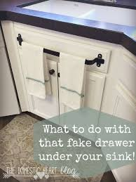 What To Do With That Fake Drawer Under Your Kitchen Sink Cabinet Towel Bar And Other Hacks