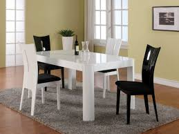 Extraordinary Rectangle White Lacquer Modern Dining Table With Four Black And Plastic Chairs Sets