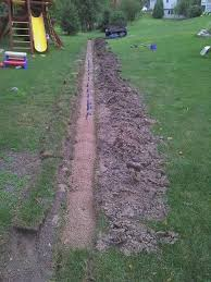 solve yard drainage issues drain tile install 5 steps