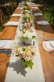 Rustic Themed Country Wedding Table Decked Up With Wooden Vase And Burlap Wrapped Decorations