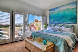 Bedroom With Ocean Wall Art Teal Bed Covers And White Plantation Shutters