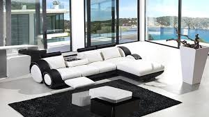 canapé noir et blanc noir et meuble blanc