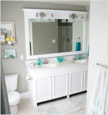 If You Have A Large Bathroom Mirror Frame It With Wood And Add Wall Sconces
