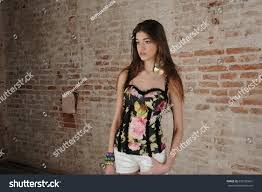 beautiful shorts posing on stone stock photo 620185601