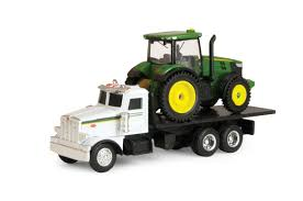 Amazon.com: Ertl Collectibles Dealer Truck With 7R Tractor: Toys & Games
