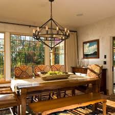 Example Of A Mountain Style Medium Tone Wood Floor Dining Room Design In Boston With Beige