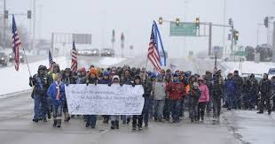 Hundreds march through snow in Oak Brook to support police officers