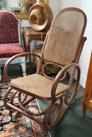 A Bentwood Rocking Chair Havana Cane Sofa Cushion Vintage Birdseye Maple Rocking Chair Woven Seat Sewing Mid Century Danish Modern Rope Wegner Pair Of Chairs Rosewood Carved With Cane Weaving Vti Chennai Antique Woven Rocking Chair Butter Churn On Wooden Malawi White Mid Century Arthur Umanoff Cord Rope Wicker Rocker Rustic Primitive Armchair Glider Seating Rattan Shabby Chic Coastal Country French Nursery Old Wooden Isolated Stock Photo