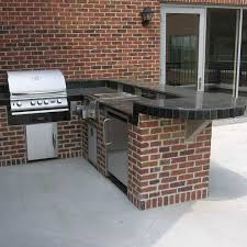 The With A Grill Refrigerator And Burners This L Shaped Outdoor Kitchen Is