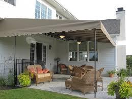 Palram Feria Patio Cover by Custom Sunbrella Fabric Deck Canopy With A Black Ceiling Fan And A