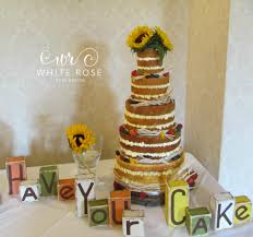 Naked Wedding Cake With Sunflowers By White Rose Design Cakes In West Yorkshire