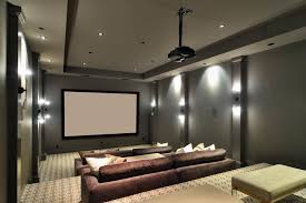 contemporary home theater with wall sconce high ceiling in