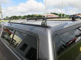 Thule Roof Rack For Truck Cap - Lovequilts Shop Hauler Racks Universal Heavy Duty Alinum Cap Rack At Lowescom Misc Suburban Toppers Leer Truck And Mopar Bedrug Install Protect Your Cargo Photo Thule Rapid Podium Aeroblade Roof On Tracks For Fiberglass Ladder World Installing A The New Tacoma Augies Adventuraugies For Lovequilts Pickup Topper 2 Bar Van Gallery 15c F150 Jason Zone With Double T Industrial Supply From Xterra Nissan Frontier Forum Advice Need Truck Cap Rack Toyota Fans