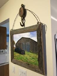 An Old Barn Pulley Some Barb Wire & Barn Wood And There You Have ... Diy Barnwood Command Center Fireside Dreamers Airloom Framing Signs Fniture Aerial Photography Barn Wood 25 Unique Old Barn Windows Ideas On Pinterest Window Unique Picture Frames Photo Reclaimed I Finally Made One With The Help Of A Crafty Dad Out Old Door Reclamation Providing Everything From Doors Wooden Used As Frame Frames 237 Best Home Decor Images And Kitchen Framemy Favorite So Far Sweet Hammered Hewn Super Simple Wood Frame Five Minute Tutorial