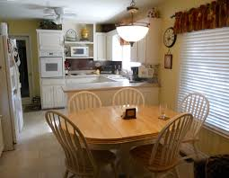 Kitchen Dining Room Table Chairs Lamps Clock Microwave Freezer Sink Stove Windows Shaer Door Ceiling Floor Wood Set