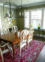Eclectic Dining Room With Decorative Plate Wall