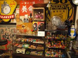 Vintage Toys In Glass Cases And Tin Signs