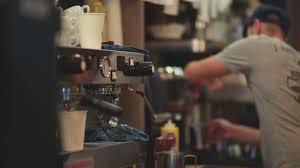 Barista Making Coffee Using Espresso Machine