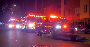 Flashing Emergency Lights Of Fire Trucks Illuminate Street Of West ...