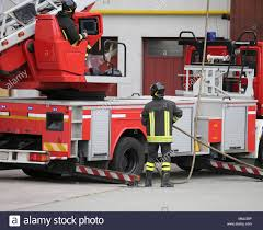 100 Big Red Fire Truck Big Red Fire Engine With Aerial Ladder And Firefighters During An