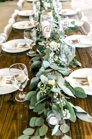 Long Feasting Table With Garland Greenery Centerpieces And Wooden Farm Tables Rustic Country Wedding Reception Decor Inspiration