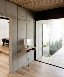 100 Concrete House Design Christopher Robertson Overlaps Concrete Timber Volumes In Texas Home