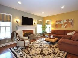 Traditional Carpet With Brown L Shaped Sectional Sofa For Modern Living Room Interior Design Yellow Accent