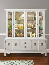 An Update On The Classic Dining Room Hutch A Display Case Painted High Gloss White Holds Golds And Greens Of Many Shades