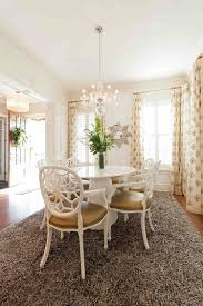 Dinning Rooms Gorgeous Dining Room With Round Wood Table And Lovely Chandeliers White Chairs Grey Fluffy Rug Rustic Jute Seagrass Rugs Oval Rag Throw Mint