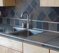 acid stained tile counter tops and backsplash with light