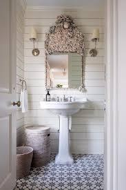 seashell mirror with pedestal sink cottage bathroom