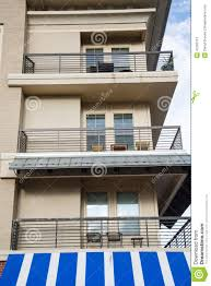 Condo Balconies Over Blue And White Awning Stock Image - Image ... Metal Front Porch Awnings Door Wooden Awning Wood For Home Pergola Design Fabulous Alinum Pergola With Retractable Canopy Pop Up Uk Gazebo White Carrying Bag White Pella Windows With Awning Matched Faux Brick Wall For Decor Exterior Design Sensational Wall X Tent W 4 Removable Window Side Vintage Trailer From Oldtrailercom 72018 Sunbrella Shade Collection Beneficial Patio Your Perfect Day Patio Closeup Of Bluewhite Striped Above Blue Front Door In Guard Protect Your Rv The Sun And Weather