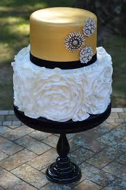 Rosette ruffle wedding cake with gold metallic and brooches Could use this as a template for Black And Gold Birthday