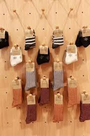 Our Ingenious Sock Display Pegboard