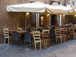 SIENA, ITALY - CIRCA JULY 2016: Outdoor Restaurant With Tables ... Cofoco Italy By Norm Architects Fniture Makeover Diy Ding Chairs Exclusive Designs Luxury Seating Custom Made Bl Station We Make Innovative Design Using Carefully Stua Design Fniture Italia Chair Cafe Restaurant Italian Home Furnishing Calligaris Artek 36 Of The Best Rooms 2016 Architectural Digest Cassina Designer And Interior Welcome To World Actona Company Art
