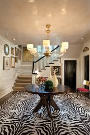 An Oversized Zebra Print Rug Makes A Striking First Impression In The Reception Hall