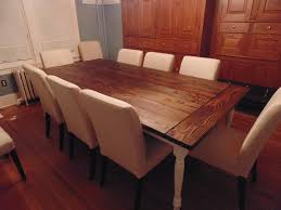 hand crafted reclaimed wood farmhouse table with beautiful turned