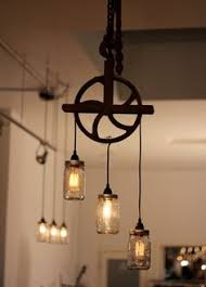 pulley chandelier with jar pendant lights and edison bulbs