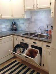 Big Plans Little Budget Tip Out Trash And Recycling CenterIDEA Cans On The Island Doors Appliances In Back