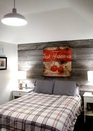 View In Gallery Farmhouse Style Bedroom With A Modest Reclaimed Wood Feature Wall Design Barnboardstore