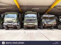 100 German Trucks BURG GERMANY JUNE 25 German Military Trucks Stands Under Stock