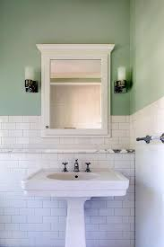 white and green bathroom with marble ledge shelf sink