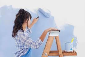 Woman Painting Walls Blue