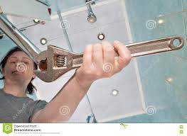 Faucet Aerator Removal Tool by Woman Removing Old Tap Aerator Using An Adjustable Plumbing Span