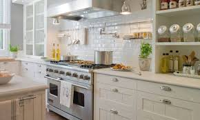 Kitchen With Mounted Pot Filler Faucet And White Cabinets