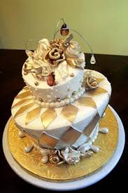 Two tier mad hatter white and gold wedding cake