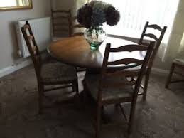 ERCOL DINING ROOM TABLE AND CHAIRS