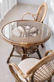 Glass Table And Rattan Wicker Seat Chair. Wicker Furniture Rattan.. 315 Round Alinum Table Set4 Black Rattan Chairs 8 Seater Ding Set L Shape Sofa Brown Beige Garden Amazoncom Chloe Rossetti 17 Piece Outdoor Made Coffee Table Set Stock Photo Image Of Contemporary Hot Item Modern Fniture Stainless Steel And Lordbee Large 5 Pcs Patio Wicker Belleze 3 Two One Glass Details About Chair Cushion Home Deck Pool 3pc Durable For Pcs New Y7n0