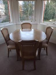 LIKE BRAND NEW FISHPOOLS ROUND DINING TABLE FOUR CHAIRS